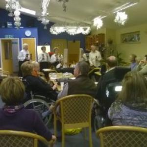 Great Barton Hand Bell ringers entertain the Stroke Club at Village Hall smaller version